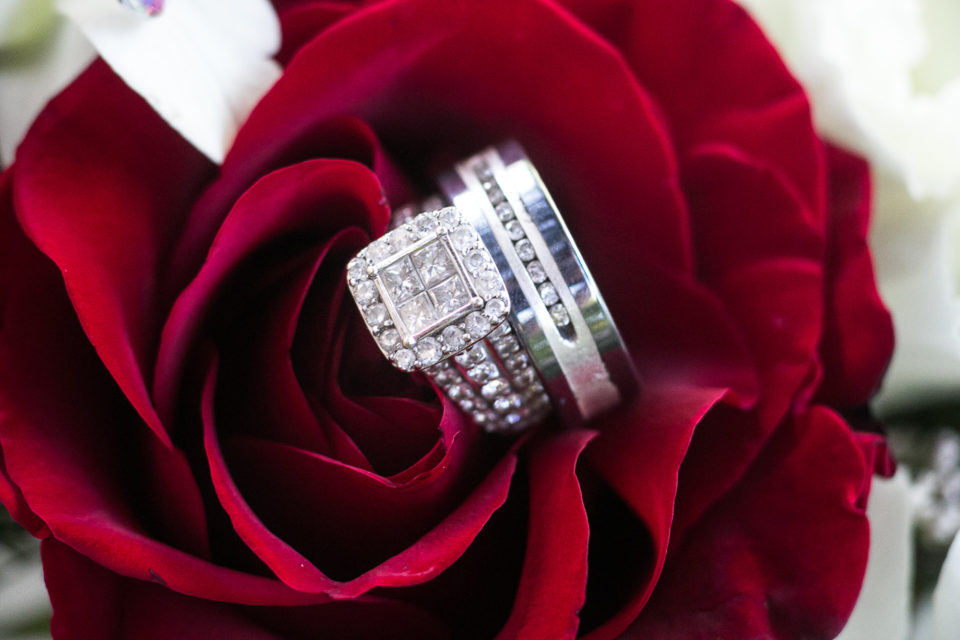 wedding rings in a rose
