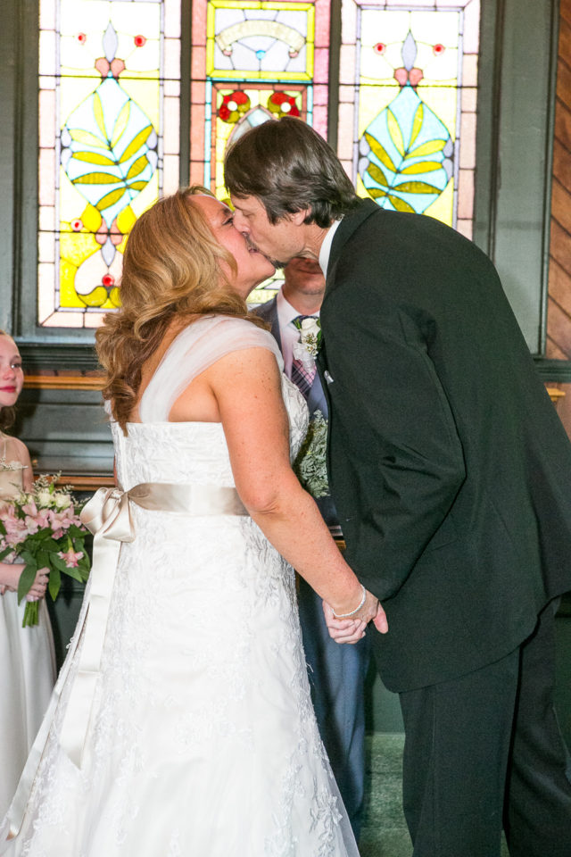 Kathryn and James kiss on their wedding day