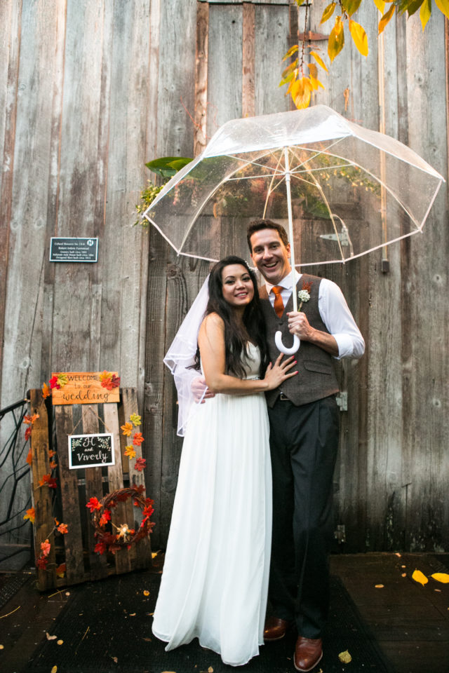 Viv and H stand in front of the Mcmenamins Octagonal Barn on their wedding day