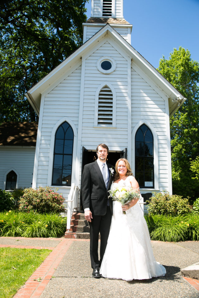 Kathryn and James stand in front of Oaks Sellwood Church