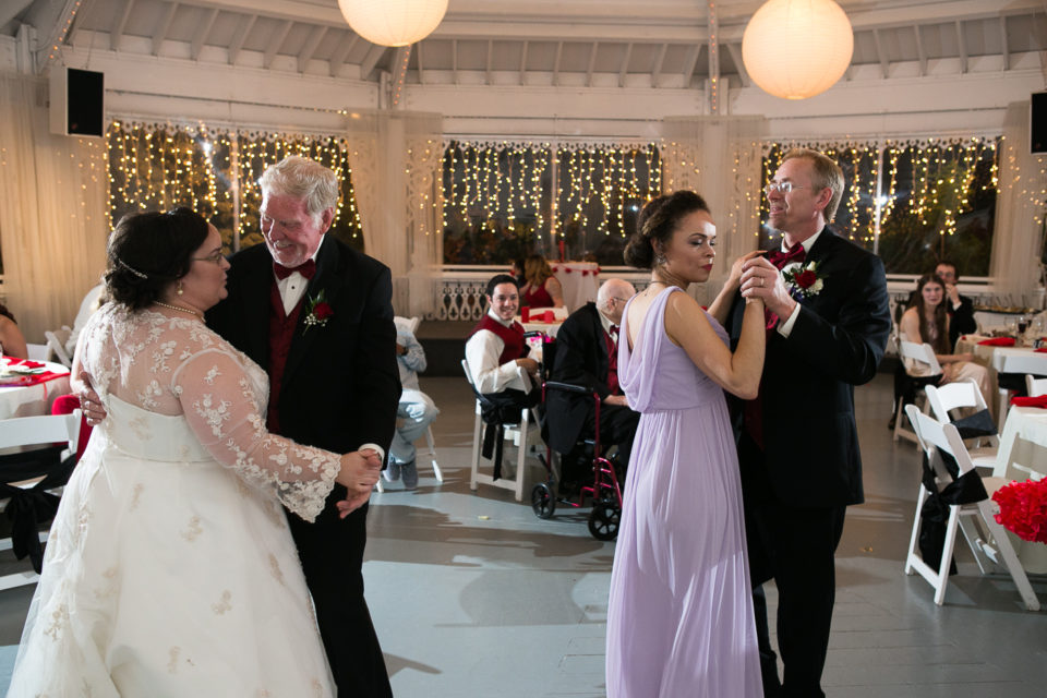 The family of Tamara & Chris dance on their wedding day